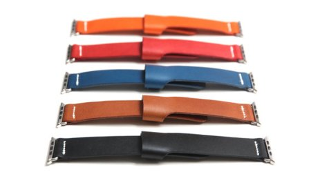 five watch bands with no watch faces attached; from top to bottom they are orange, red, blue, brown and black