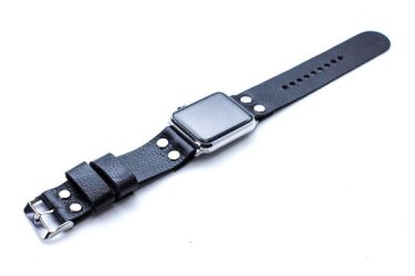 Apple Watch with black leather band featuring silver grommets